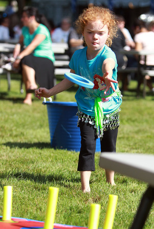 Ipswich: Cameron Redmond, 6, of Rowley, concentrates while playing ring toss at the annual Greek Festival held at the Hellenic Center in Ipswich. David Le/Salem News