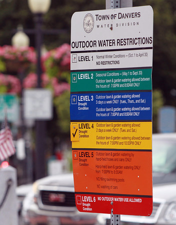 Danvers: The Outdoor Water Restrictions sign in downtown Danvers is marked Level 4, allowing residents to only water their lawn and gardens twice a week (Tuesdays and Saturdays), and between the hours of 7pm and 10pm. David Le/Salem News