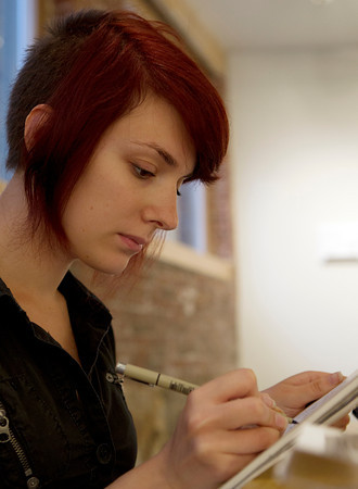 Beverly: Val Toukatly, of Beverly, concentrates while drawing inside a gallery at Wicked Art Bar on Rantoul Street on a rainy Thursday afternoon. David Le/Salem News