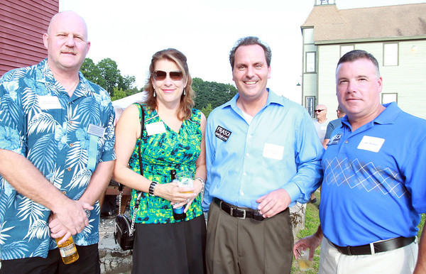 Peabody: From left, Rudy and Kathy Van Oeveren, Scott Frasca, and Dave McGovern, at the Peabody Area Chamber of Commerce's summer networking event held at Smith Barn at Broooksby Farm on Wednesday evening. David Le/Salem News
