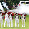 Marblehead: A few red coat re-enactors fire their muskets across Seaside Park during a re-enactment on Saturday afternoon. David Le/Salem News