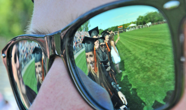 Beverly: Beverly High School class of 2011 graduates are reflected in Mike Doane's glasses.  photo by Mark Teiwes / Salem News