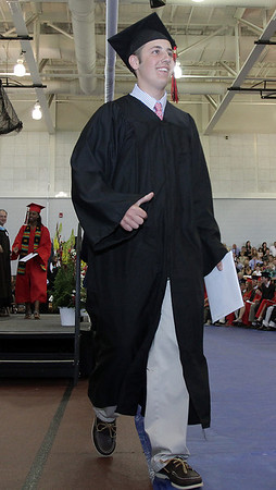 David Le/Salem News. Marblehead High School senior Garrett Callahan gives his family the thumbs up after receiving his diploma on Sunday afternoon at Marblehead High School. 6/5/11.