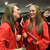David Le/Salem News. Marblehead High School seniors Madeleine Banderier and Gabby Kelley celebrate after the completion of the graduation ceremonies on Sunday afternoon. 6/5/11.