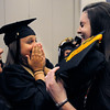 Ipswich:<br /> From left, graduates Liz Glavin, Mikhala Reedy, and Sarah Millard, share a laugh before the start of their graduation at the Ipswich High School gym Sunday afternoon.<br /> Photo by Ken Yuszkus/Salem News, Sunday, June 5, 2011.