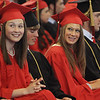 David Le/Salem News. Marblehead High School seniors Emmy York, left, Brian Drumm, center, and Courtney Maag, right, share a laugh during their graduation on Sunday afternoon. 6/5/11.