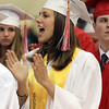 David Le/Salem News. Masco High School senior Audrey Maysek cheers on her fellow classmates as they receive their diplomas during their graduation ceremonies on Friday evening. 6/3/11.