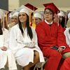 David Le/Salem News. Masco High School seniors from left, Alyssa Abraham, Whitney Adrian, Doyoung Ahn, and Melanie Albanesi, laugh at the speeches of one of their classmates during their graduation on Friday evening. 6/3/11.