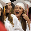 David Le/Salem News. Masco seniors Samantha Reid, left, and Corinne Rennick, right, share a smile as they prepare to receive their diplomas during their graduation ceremonies on Friday evening. 6/3/11.