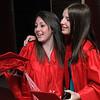 Salem:<br /> Graduates Cassandra Geezil, left, and Jennifer Jendraszek hug when they meet in the foyer of Salem High School before the graduation.<br /> Photo by Ken Yuszkus/Salem News, Friday, June 3, 2011.