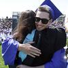 David Le/Salem News. Swampscott High School senior Nolan Surette hugs senior class advisor, Lytania Mackey after receiving his diploma on Sunday afternoon. 6/5/11.