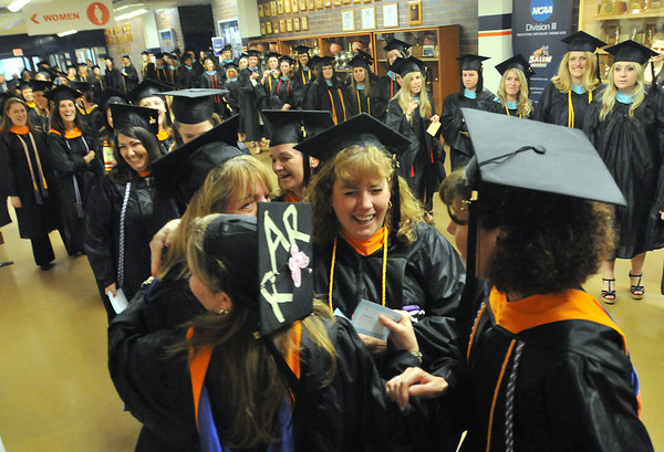 Emotions run high as students line up prior to the Salem State University grad school commencement ceremony.  photo by Mark Teiwes / Salem News