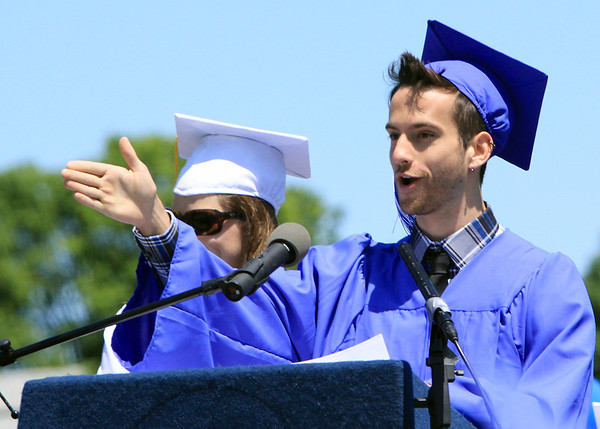 David Le/Salem News. Swampscott High School senior president Matthew Gadman, front right, and vice-president Maggie Osbahr, back left, give a speech to their classmates during graduation on Sunday afternoon. 6/5/11.