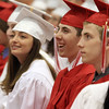 David Le/Salem News. Masco seniors Andrea Tuttavilla, left, Corey Rudor, center, and Casey Tudor, right, laugh during a speech during their graduation ceremonies last night. 6/3/11.