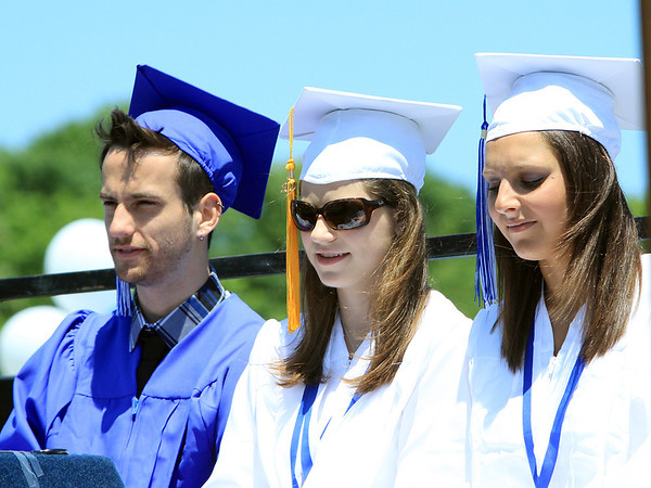 David Le/Salem News. Swampscott High School senior president Matthew Gadman, left, vice-president Maggie Osbahr, and secretary Danielle Goldman, listen to an address from Swampscott High School principal Layne Millington during their graduation ceremonies on Sunday afternoon. 6/5/11.