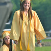 Peabody: Lisa Vassallo crosses the stage to receive her diploma at Bishop Fenwick High School graduation.  photo by Mark Teiwes / Salem News