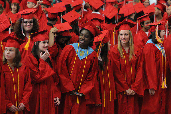 "Salem:<br /> The graduates exhibit different expressions as ""Pomp and Circumstance"" is played during the processional at the beginning of Salem High School graduation.<br /> Photo by Ken Yuszkus/Salem News, Friday, June 3, 2011.<br /> , Salem:<br /> The graduates exhibit different expressions as ""Pomp and Circumstance"" is played during the processional at the beginning of Salem High School graduation.<br /> Photo by Ken Yuszkus/Salem News, Friday, June 3, 2011."
