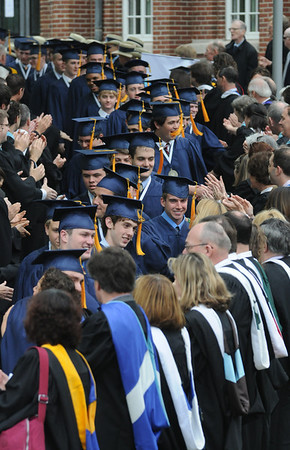 Danvers: St John's Prep seniors make their way through a line of congradulating faculty on their way to commencement Sunday morning. Jim Vaiknoras/Staff photo