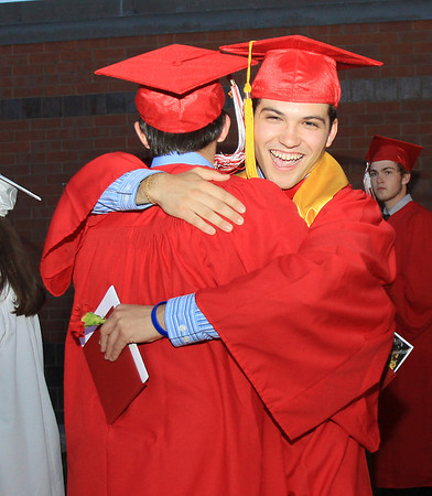 David Le/Salem News. Masco High School seniors Jameson Casey, left, and Nick Bettencourt, right, embrace outside the high school after their graduation on Friday evening. 6/3/11.