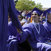 David Le/Salem News. Swampscott High School senior Robert Beatrice shakes the hand of a classmate after they received their diplomas on Sunday afternoon. 6/5/11.