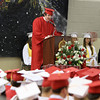 "David Le/Salem News. Above a sea of red and white hats, Masco High School senior Vincent Liberto reads his essay entitled ""Stand-Up"" during their graduation ceremonies on Friday evening. 6/3/11."
