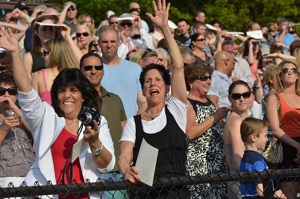 Peabody: Brenda Newman and her sister Terry cheer for graduate Brianna Newman at the start of Bishop Fenwick High School graduation. photo by Mark Teiwes / Salem News