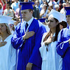 David Le/Salem News. Swampscott High School seniors from left, Nicole McDermott, Kennan McClung, Christi Mazareas, and Christopher Mason put their hands over their heart during the playing of the Star Spangled Banner at the beginning of their graduation ceremonies on Sunday afternoon. 6/5/11.