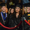 Salem: Graduates listent Juliana Silva deliver the student address at Salem State University's College of Health and Human Services and the Bertolon School of Business comencement ceremony.   photo by Mark Teiwes / Salem News