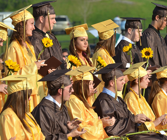 Peabody: Bishop Fenwick High School graduates proudly hold diplomas and sunflowers. photo by Mark Teiwes / Salem News