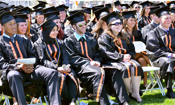 Beverly: The Beverly High School class of 2011 reacts with smiles during Valedictorian James Powers speech. photo by Mark Teiwes / Salem News