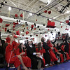 David Le/Salem News. Marblehead High School seniors throw their caps in celebration and jubilation after being announced as offical graduates on Sunday afternoon in the Marblehead High gymnasium. 5/6/11.