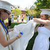 Wenham:<br /> Hamilton-Wenham grads Caroline Goodrich, left, and Evie Unsworth don their gowns as the line forms for the processional at the Hamilton-Wenham graduation held at the Gordon College chapel on Sunday at noon.<br /> Photo by Ken Yuszkus, Salem News, Sunday June 2, 2013.