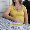 Danvers:<br /> Kezia Fitzgerald pledges to shave her head after losing her 18 month old daughter Saoirse to neuroblastoma, a form of pediatric cancer.<br /> A poster about the Kids Cancer Buzz-Off event is in the foreground.<br /> Photo by Ken Yuszkus, Salem News, Tuesday, June 4, 2013.