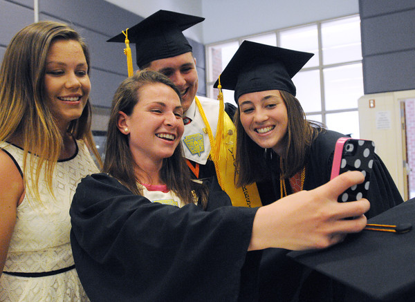 Ipswich:<br /> Ipswich grads from left, Isabelle O'Connor, Sarah Keiran, Dewey Robinson, and Rebecca Goulet-Martel take a photo together as the seniors assemble prior to the processional for the Ipswich graduation on Sunday.<br /> Photo by Ken Yuszkus, Salem News, Sunday June 2, 2013.