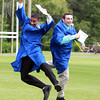Danvers: Danvers High School graduates Kyle Butler, left, and Mike Mazola, right, leap in the air in celebration after graduation on Saturday afternoon. David Le/Salem News