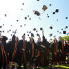 Beverly: Beverly High School graduates throw their mortar boards high in the air at the conclusion of the Graduation Ceremonies on Sunday afternoon. David Le/Salem News