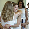 Wenham:<br /> Hamilton-Wenham grads Caroline Fallon, left, and Claire Pacione hug upon meeting prior to the Hamilton-Wenham graduation held at the Gordon College chapel on Sunday at noon.<br /> Photo by Ken Yuszkus, Salem News, Sunday June 2, 2013.
