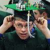 Danvers:<br /> Graduate Robert Daigle of Peabody, places his mortarboard which he embellished with Legos on his head as he gets ready for the Essex Agricultural and Technical High School graduation.<br /> Photo by Ken Yuszkus / Salem News, Thursday, June 6, 2013.
