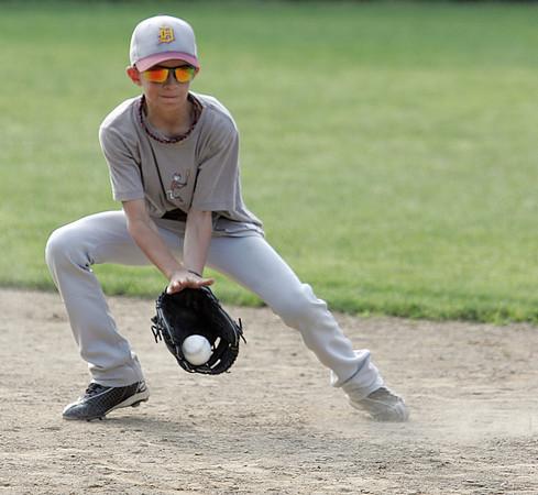 Danvers:<br /> Ian Paskowski at the Danvers National Little League practice at Phinney Field.<br /> Photo by Ken Yuszkus / Salem News, Monday, June 24, 2013.