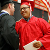 MARY SCHWALM/Staff photo  Salem High School graduate Adonis Moises Medrano shakes hands with school principal David Angeramo after receiving his diploma during the graduation ceremony at the high school in Salem.  6/7/13