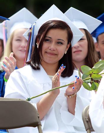 Danvers: Danvers High School graduate JennyLu Armenta claps for Senior Class Essayist Emma Weir, after her speech on Saturday afternoon. David Le/Salem News