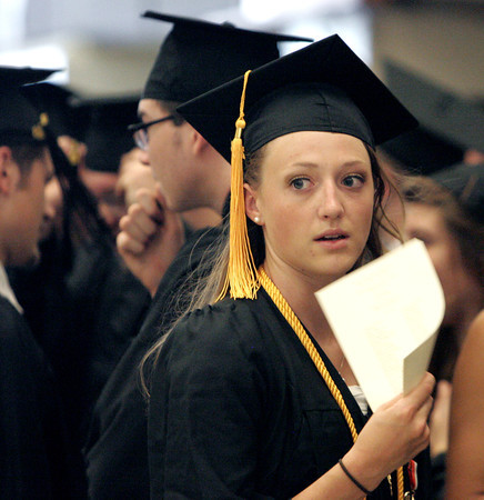 Ipswich:<br /> Ipswich grad Bryn Golesworthy tries to cool off with a makeshift fan that is the program for the graduation. She is in line for the processional into the gym for the Ipswich graduation on Sunday.<br /> Photo by Ken Yuszkus, Salem News, Sunday June 2, 2013.