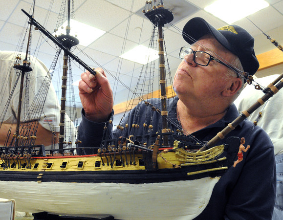 Peabody:<br /> Edward Shepherd of Swampscott is finishing his model of the H.M.S. Surprise. He is part of the Peabody Council On Aging model ship building program held at the Peter A. Torigian Community Center.<br /> Photo by Ken Yuszkus, Salem News, Monday, June 3, 2013.