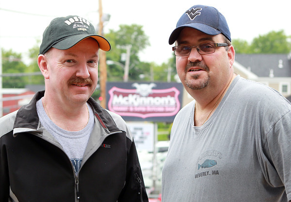 Danvers: Brian Harrison, right, and Keith Burgess, left, are taking part in the 13th Annual Roof Top Retreat in hopes of raising $20,000 for the Cystic Fibrosis Foundation, on top of McKinnon's Market on Holten St. in Danvers. David Le/Salem News