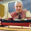Peabody:<br /> Lloyd Sanborn of Haverhill is just about finished his model of a steam trawler. He is part of the Peabody Council On Aging model ship building program held at the Peter A. Torigian Community Center.<br /> Photo by Ken Yuszkus, Salem News, Monday, June 3, 2013.