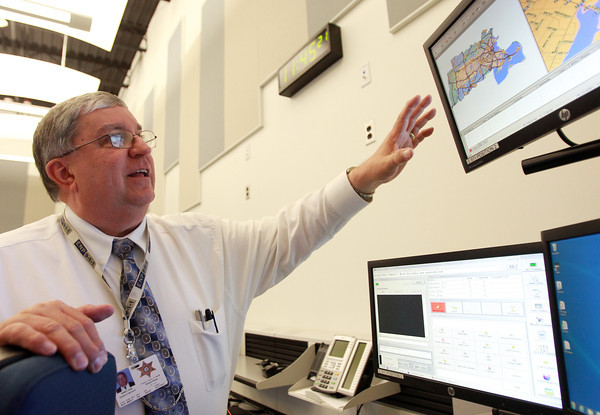 Middleton: Tom Dubas, Director of the new Regional Emergency Communications Center, explains some of the standard operating procedures for incoming emergency calls in the new facility on Friday morning. David Le/Salem News