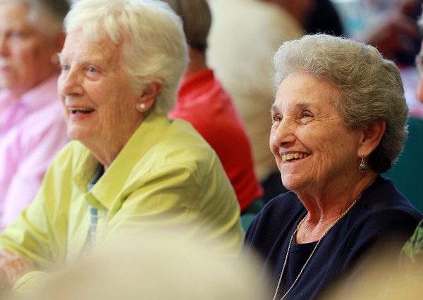 Danvers: Loretta Nolan, right, and Phyllis Sullivan, smile as they listen to a musician during the Senior Citizen Luncheon at the Danvers Senior Center on Tuesday afternoon. David Le/Salem News