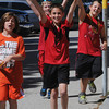 Peabody:<br /> From left third graders Gavin Russell, Benjamin McKiernan, Billy Sperounis, and Brendan Smith walk around Peabody's Center School during the walk-a-thon to raise money for school.<br /> Photo by Ken Yuszkus, Salem News, Wednesday, June 5, 2013.