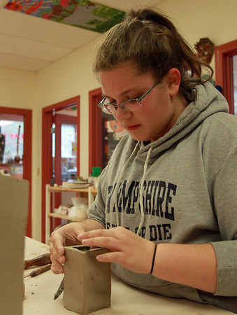 Beverly: Jillian Stanton, 17, of Peabody, works carefully to sculpt her clay piece, during Afterschool Teens in Clay, at Clay Dreaming Pottery Studio on Monday afternoon. David Le/Salem News