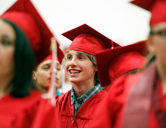 MARY SCHWALM/Staff photo  Salem High School graduate Jacob Disick smiles during the graduation ceremony at the high school in Salem.  6/7/13